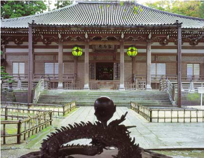 Naga forms decorate the great incense-burner in front of the Main Hall.
