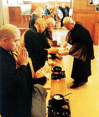 Monks chant the Meal Chant at mealtime